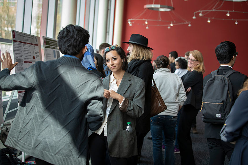 Symposium participants discussing their projects at poster session
